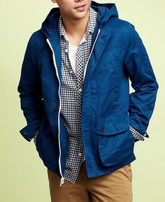 Gap    Bright blue, weather-resistant, trim fit, note-worthy design details (like that contrasting zipper), and a protective hood. This nails it all.    Hooded anorak ($118) by Gap, gap.com