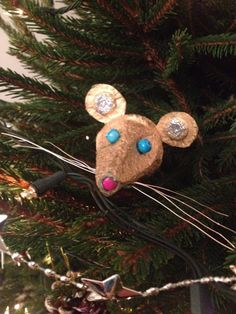 Homemade and recycled Christmas tree decorations - egg box mice faces.