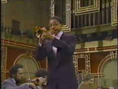 Wynton Marsalis performs the Haydn Trumpet Concert in Eb with the Boston Pops Orchestra, John Williams conducting.