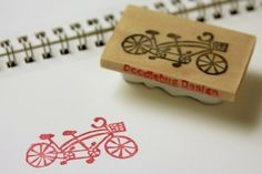 Hand Carved Stamp Tiny Tandem Bicycle. $12.00, via Etsy.
