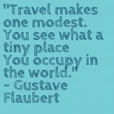 We travel to become modest.
