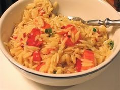 Giada's orzo salad... I've made it twice already and it gets better each time.  Add grilled chicken to make it more filling. Perfect for a hot summer day (serve cold)