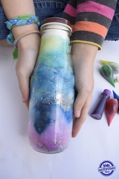 "Sensory bottles are fun for kids, but what if your kids, no longer call themselves ""kids""?  But they still love crafts?  This is the sensory bottle for them! These glowing galaxy jars are fun and easy to make – the more ""grown-up"" version of our Counting Stars Glowing Bottle, do not require mom's involvement (even younger...Read More »"