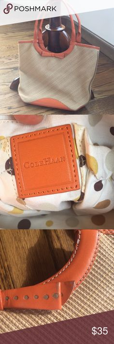 Cole Hana purse Orange and tan. Used condition. Some staining in interior but no holes or tears. Lipstick stain shown. Markings on the bottom and on part of bow, also shown. Cole Haan Bags Shoulder Bags