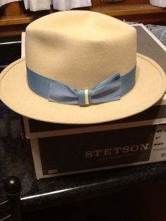 Falcon Park Hattery custom hat. Retail $160.00 Rabbit fur felt color is bone. Summer blue ribbon with a yellow accent.Customer hatters are the way to go when you know exactly what you want.