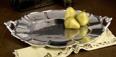 Beatriz Ball Latur Gallones Oval Tray - Large,fashioned by hand, tray constructed of FDA approved 93% aluminum alloy. Following four levels of hand polishing, the tray boasts a luminous shine, and it will not tarnish, so polishing is not required. Oven safe to 350 degrees. Please hand wash only. Crafted by artisans in Mexico, the Latur Gallones Oval Tray measures 24 inches long, 16-1/4 inches wide, and 1-1/4 inches high…