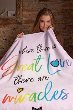 "This comfy and warm ""Where There Is Great Love, There Are Miracles"" fleece blanket is super soft and perfect for staying warm in winter and curling up by the fire! It's available in multiple sizes. Also be sure to grab a few extra ""Where There Is Great Love"" inspirational blankets because they make the best Christmas gifts and birthday presents! This cute blanket is sure to become a favorite for people who love positive quotes and sayings. Kids absolutely love them! Great Love, Love You, Cuddling On The Couch, Cute Blankets, Inspirational Quotes Pictures, Best Christmas Gifts, Kid Beds, Curling, Birthday Presents"