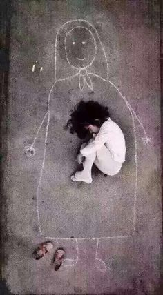 A photograph purportedly showing an orphan lying in a chalk outline of her absent mother has a very different backstory; one of creativity rather than tragedy...