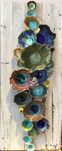 """Wall ceramic sculpture depicting corals and barnacles. Size: 24"""" x 10"""". Reclaimed Wood Wall Art; Ceramic Coral Reef Wall Application; Ocean Reef; Underwater Cor"""