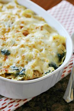 Spinach Artichoke Chicken Pasta Bake - My family's favorite, they request it all the time! Easy and quickly made. It's a keeper.