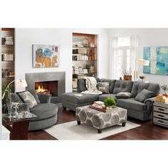 Modern Luxury. Hip and spirited, but without going overboard, the Cordelle gray sectional collection gives your space just the right amount of lush look. Decked out in today's hottest neutrals with on-trend trimmings, this sectional offers eye-catching appeal without sacrificing deep-down comfort. Tufted accents and a mottled texture lend added interest to the contemporary style. Go ahead - indulge! Two-piece sectional includes left-facing chaise and right-facing sofa, as shown.