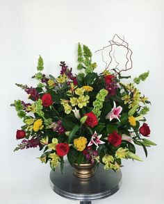 lilies, red roses, yellows, curly willow floral arrangement #campusfloral