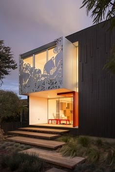 Jonathan Ward and Jin Ah Park's contemporary home was dubbed the California Poppy House for the floral-silhouette aluminum screen on its upper facade. Their design is both inherently local—an engaged, important part of the Venice community—and compellingly global (it was inspired by the couple's two-year backpacking trip around the world).