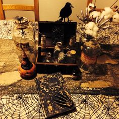 My Halloween table display! I aged potion bottles and made a cool spell book!
