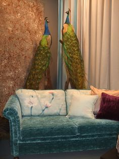 have a seat with the peacocks