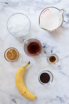 Separated ingredients for the Healthy Coffee Smoothie Recipe including coffee, banana, peanut butter, vanilla extract, and almond milk. Coffee Smoothie Recipes, Smoothie Recipes For Kids, Protein Smoothie Recipes, Apple Smoothies, Breakfast Smoothies, Smoothie Diet, Coffee Recipes, Healthy Smoothies, Healthy Detox