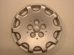 2005 Chrysler Town & Country Aftermarket Wheel Covers:  Description: 	Aftermarket Wheel Covers  AFTERMARKET WHEEL COVERS, 16 INCH,   SILVER ABS SPRING STEEL CLIP APPLICATION  Pack: 	FOUR COVER SET  Discount Price: 	$30.10  Fits: 	2005 Chrysler Town & Country  Part No: 	IWC406/16S