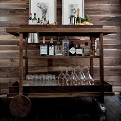 Can furniture style be both modern and rustic? This wooden bar cart could probably qualify as both. The clean lines with no curves, a middle shelf and the combination of solid wood wheels and metal swivel casters make this design stand out.