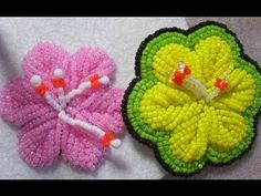 Still obsessed with it. Here I show how I made a cute hibiscus type flower with Iroquois raised bead embroidery. I really love this stuff. Thanks to everyone who dug up information for my benefit! Raised leaves: http://youtu.be/thoVWFa-hYQ