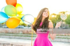 Foto de stock : Woman with balloons and lollipop