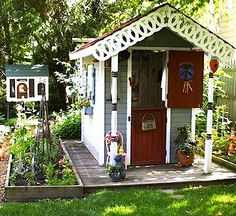 rock garden surrounds kids playhouse made from retooled shed