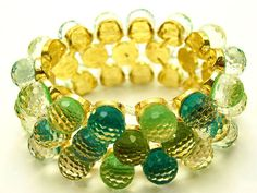 This bracelet is amazing! I love yellow/green together. So sad, she sold out of the pink/purple one!