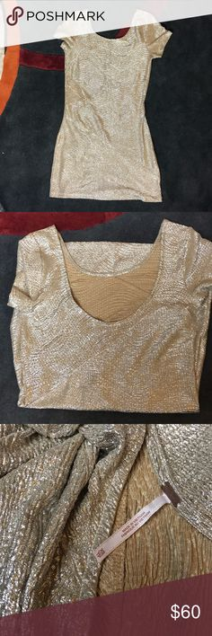 New Year's Eve dress Free people metallic dress. Ideal for Christmas, New Years Eve parties, semi formals, etc. The back is lower than the front. Tight-fit, stretchy dress. Never worn. Free People Dresses Mini