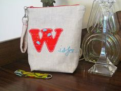 W is for Wellies zippered pouch. Raw edge applique and free motion embroidery.