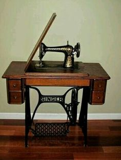 Antique Singer sewing machine - looks just like the one I have that  originally belonged to my paternal grandmother