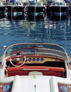 Ariston with Lobster interior, facing other beautiful Riva boats at a marina.