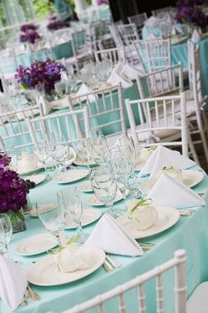 Love the Tiffany blue wedding table setting and the ivory accents this is how I want the table to look, but with red accents not purple