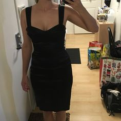 Black Halo Dress. Slightly padded bust detail. Black Halo black dress with nice detail on breast area. Very thin pads on bust area. Thick straps. Size 2. Only worn once. 95% Viscose, 5% Elastic. Black Halo Dresses