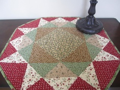 Quilted Octagon Round Table Top Topper Quilt Runner red tan green. $38.00, via Etsy.