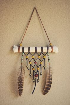 olden. a woven bohemian wall hanging. by RootsandFeathers on Etsy, $48.00