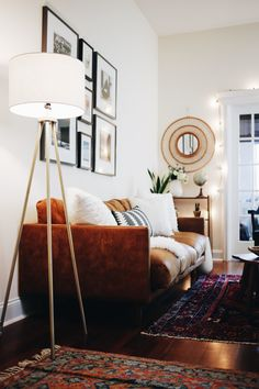 leather mixed with oriental rugs + gold accents