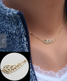 Angel wing necklace. So pretty! I'm obsessed with angel wings!!