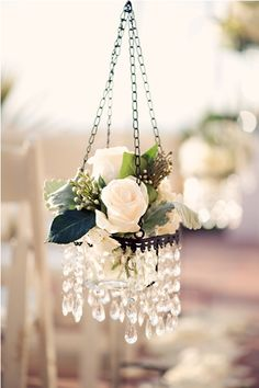 Doing this for SIL's wedding. Craft Warehouse had 2 tiered hanging votive holders 4/$12 & bought various purple flowers from the $ store.