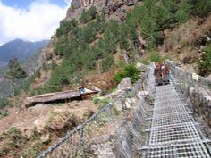 2 Sherpa women crossing the bridge to home. www.jeffreyrasley.com
