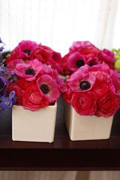 Pink anemonies & ranunculus! Love!! Different colors but cute center pieces!