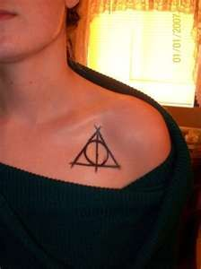 the symbol of the deathly hallows. now that is some hp dedication.