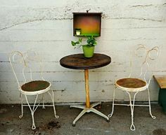 Nice petite bistro table made out of an old industrial spool top. Found chairs to match! Great for small patios. $175
