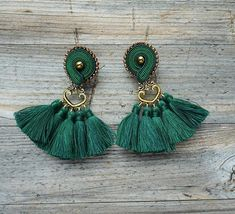 Earrings made in soutache embroidery technique. The color of green and gold. Material: hematite, toho beads, hand made tassels, decorative elements; Earrings length 8 cm (with earwire) 3.1 inch Finished with black felt. Impregnated. If you have a question, write to me :)
