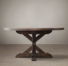 RH's Salvaged Wood X-Base Round Dining Table:Our salvaged beam wood tables are handcrafted of unfinished, solid salvaged pine timbers from 100-year-old buildings in Great Britain.