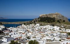 Greece | Lindos, Greece... a beautiful village on the Greek island of Rhodes. Comes complete with ancient tales and artefacts of Greek temples, a shipwrecked apostle St Paul, Byzantine Empries, and Crusader Knights.