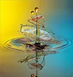 water drop by parminder singh on 500px As a child, I would look at the rain drops both falling and hitting and think they looked like dancing couples. They are so beautiful!