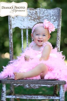 1 year baby girl model princess photo shoot: pink feather dress, hair bow, sweet smile, happy girl, perfect