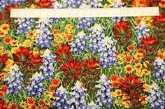 Blomster mark Patchworkstof - alle blomster. Er et flot grøn patchwork stof med flotte blomster på i mange farver.