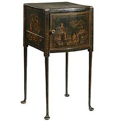 18th C. Chinoiserie Cupboard  Convex cupboard on tapered legs.