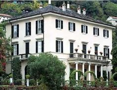 """George Clooney purchased this 25-room Italian lakeside estate villa in Laglio 2001. Known as Villa Oleandra, it has an outdoor theater, a large swimming pool and a garage for Clooney's motorcycles. Clooney has some illustrious neighbors as such Donatella of Versace who owns a home on Lake Como near the burial place of her late brother Gianni.    Clooney really admires this home and says, """"I go there whenever I can. It's where I wrote Good Night And Good Luck."""""""