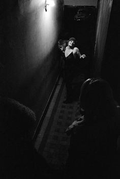 Blondine at the door, Rue des Lombards, Paris, 1976-1977 by Jane Evelyn Atwood